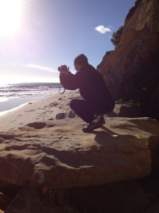 Taking pictures of the surf and sun in the Mesa.